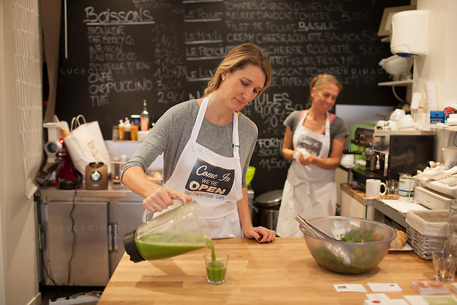 Kristen Beddard, 29, of The Kale Project, prepares a kale shake at The Superfoods Cafe, while owner Elke Seyser looks on, in Paris, France.  Kevin German / Luceo