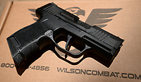 Wilson Combat in Berryville is working with gun maker Sig Sauer to provide custom work on two of the company's most popular handguns. This P365, seen Wednesday, March 4, 2020, features the Wilson Combat sights as well as improved machine work and the Wilson Combat logo. Visit nwaonline.com/200308Daily/ for today's photo gallery.<br /> (NWA Democrat-Gazette/Andy Shupe)