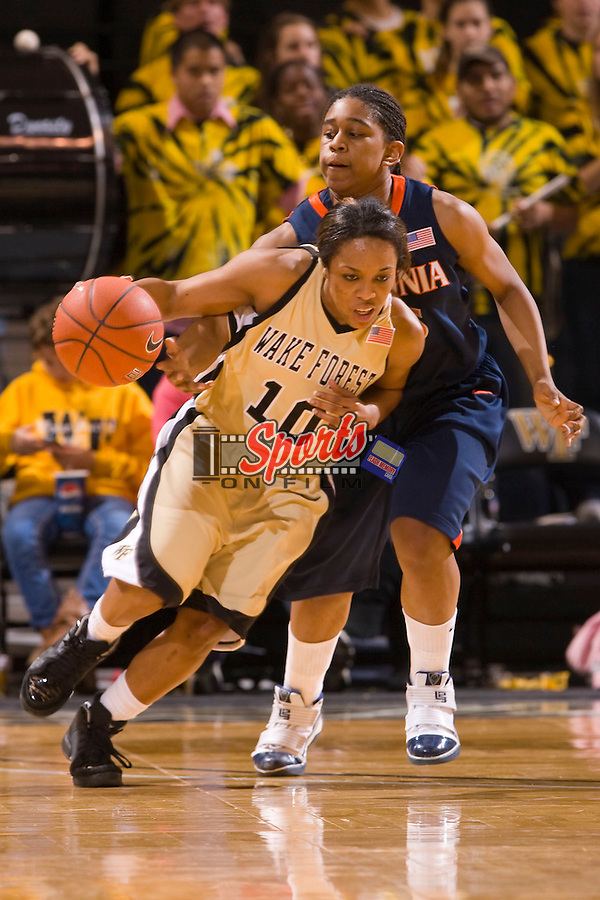 Tiffany Roulhac #10 of the Wake Forest Demon Deacons keeps the ball away from Ariana Moorer #15 of the Virginia Cavaliers at the LJVM Coliseum January 31, 2010 in Winston-Salem, North Carolina.  The Demon Deacons defeated the Cavaliers 64-57.  Photo by Brian Westerholt / Sports On Film