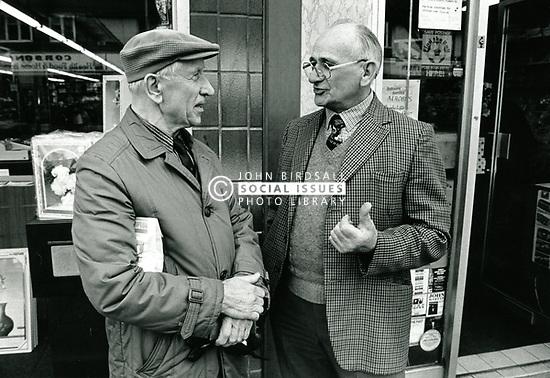 Two men chatting in the street, Nottingham UK 1989