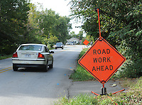 NWA Democrat-Gazette/ANDY SHUPE<br /> Traffic passes Tuesday, Sept. 22, 2015, along Old Wire Road in Fayetteville. The city of Fayetteville Engineering Division is planning to add bike lanes, sidewalks, curb and gutter to the half-mile stretch of street. Construction is expected to begin in mid-2016 and take approximately 12 months to complete.