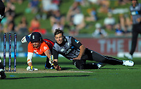 New Zealand captain Tim Southee tries to run out England captain Eoin Morgan during the 4th Twenty20 International cricket match between NZ Black Caps and England at McLean Park in Napier, New Zealand on Friday, 8 November 2019. Photo: Dave Lintott / lintottphoto.co.nz