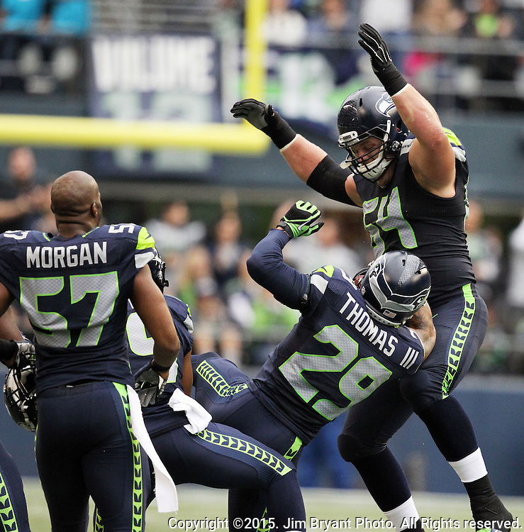 Seattle Seahawks free safety  Earl Thomas (26) celebrates with teammates after he intercepted a pass from Carolina Panthers wide receiver Jerricho Cotchery (82)  at CenturyLink Field in Seattle on October 18, 2015. The Panthers came from behind with 32 seconds remaining in the 4th Quarter to beat the Seahawks 27-23.  ©2015 Jim Bryant Photography. All Rights Reserved.