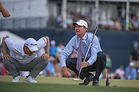 John Huh (USA), Nate Lashley (USA) and an official look closely at the green on 18 during round 4 of the Houston Open, Golf Club of Houston, Houston, Texas. 4/1/2018.<br /> Picture: Golffile | Ken Murray<br /> <br /> <br /> All photo usage must carry mandatory copyright credit (&copy; Golffile | Ken Murray)