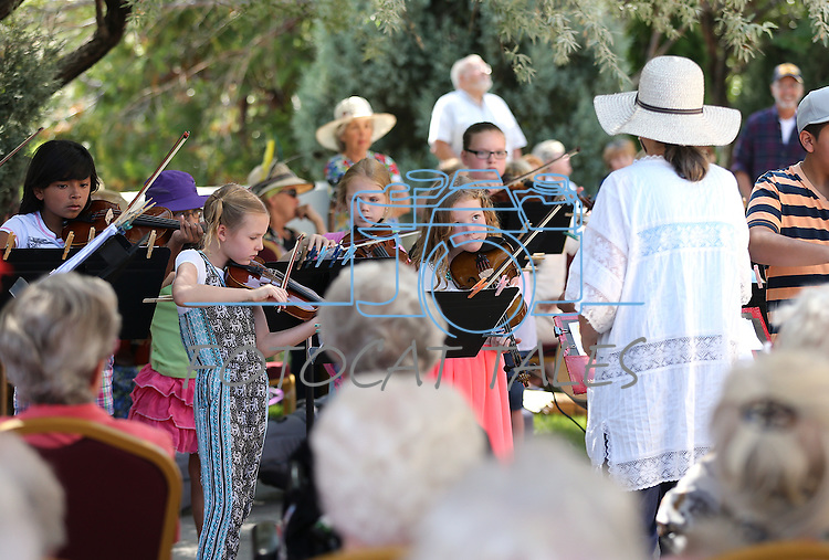 Sue Jesch leads musicians in her Strings in the Summer program during a performance at Sierra Place in Carson City, Nev., on Thursday, July 29, 2015.<br /> Photo by Cathleen Allison