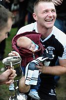 30-11-2014: Ardfert's Shane Griffin with his son Shay celebrate their victory over Valley Rovers in the Munster GAA Club Intermediate Football final in Killarney on Saturday.<br /> Picture by Don MacMonagle XXJOB