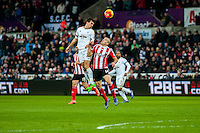 Jack Cork of Swansea City  and Oriol Romeu of Southampton  jump for the ball during the Barclays Premier League match between Swansea City and Southampton  played at the Liberty Stadium, Swansea  on February 13th 2016