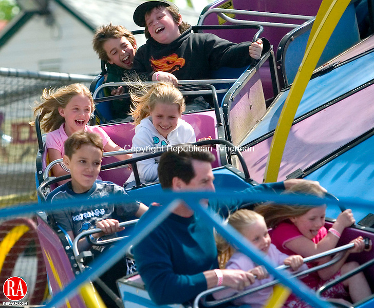 MIDDLEBURY, CT- 26 APRIL 2008- 042608JT12- <br /> Hope Goodman, 8, and Allison Gilson, also 8, boht of West Hartford, enjoy the &quot;Spin Out&quot; ride at Quassy Amusement Park in Middlebury on the park's 100th season opening on Saturday.<br /> Josalee Thrift / Republican-American
