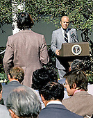 "United States President Gerald R. Ford listens to a reporter's question during a press conference in the Rose Garden at the White House in Washington, D.C. on October 9, 1974.  The President said he did not think the country was in a depression and that inflation would be reduced in 1975.  He also said his proposed 5% tax would not extend beyond 1975.  Ford is wearing a red button with the letters ""WIN"" on his lapel.  ""WIN"" stands for ""Whip Inflation Now"".<br /> Credit: Barry Soorenko - CNP"