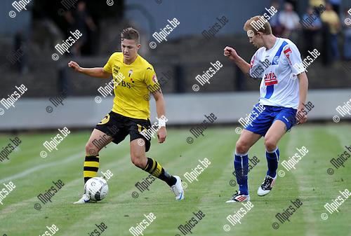 2012-08-22 / Voetbal / seizoen 2012-2013 / Berchem Sport - Temse / Stef Van den Heuvel (l. Berchem) met Niels Ringoot..Foto: Mpics.be