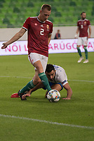 Adam Lang (top) of Hungary and Giorgos Tzavellas (bottom) of Greece fight for the ball during the UEFA Nations' League qualifying match between Hungary and Greece at the Groupama Arena stadium in Budapest, Hungary on Sept. 11, 2018. ATTILA VOLGYI
