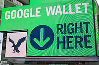The giant illuminated video display on the exterior of the American Eagle Apparel store in Times Square in New York promotes the use of Google Wallet for purchases, seen on Monday, January 21, 2013.  (© Frances M. Roberts)