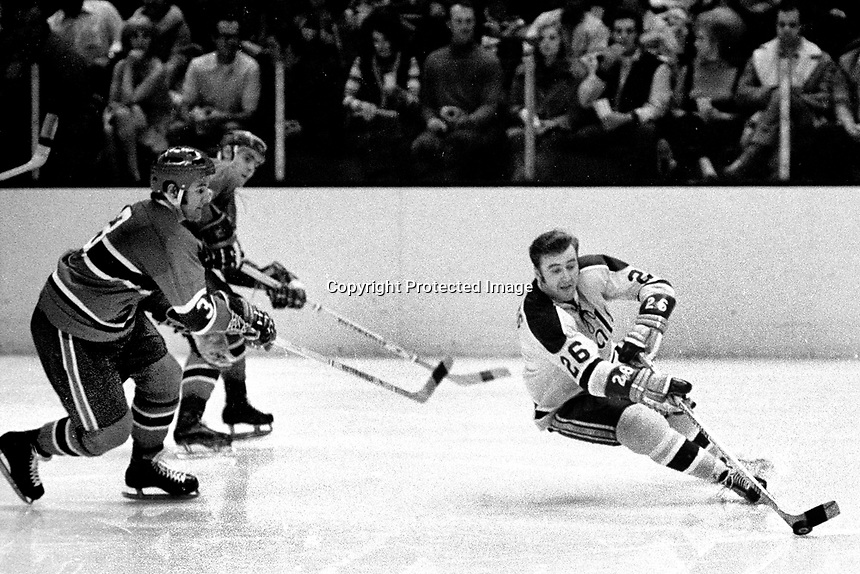 California Golden Seal Tom Williams against the Montreal Canadaiens..(1971 photo/Ron Riesterer)