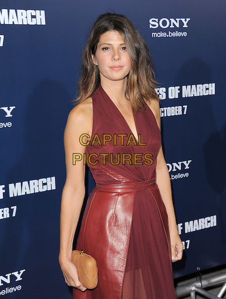 Marisa Tomei.The L.A. Premiere of 'The Ides of March' held at The Academy of Motion Picture Arts & Sciences  in Beverly Hills, California, USA..September 27th, 2011.half length halterneck dress sheer chiffon leather clutch bag brown purple pink aubergine.CAP/RKE/DVS.©DVS/RockinExposures/Capital Pictures.