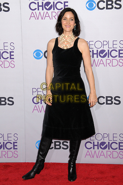 Carrie-Anne Moss.People's Choice Awards 2013 - Arrivals held at Nokia Theatre L.A. Live, Los Angeles, California, USA..January 9th, 2013.full length dress boots black sleeveless pearls necklace .CAP/ADM/BP.©Byron Purvis/AdMedia/Capital Pictures.