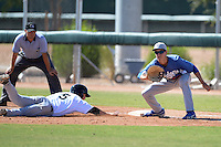 Los Angeles Dodgers first baseman Cody Bellinger (76) takes a pick off attempt as Tyler Shryock (5) dives back to first during an Instructional League game against the Chicago White Sox on October 12, 2013 at Camelback Ranch Complex in Glendale, Arizona.  (Mike Janes/Four Seam Images)