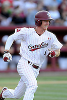 Right fielder Connor Bright (4) of the South Carolina Gamecocks bats in an NCAA Division I Baseball Regional Tournament game against the Maryland Terrapins on Sunday, June 1, 2014, at Carolina Stadium in Columbia, South Carolina. Maryland won, 10-1, to win the tournament. (Tom Priddy/Four Seam Images)