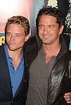 LOS ANGELES, CA - OCTOBER 18: Jonny Weston and Gerard Butler arrive at the 'Chasing Mavericks' - Los Angeles Premiere at Pacific Theaters at the Grove on October 18, 2012 in Los Angeles, California.