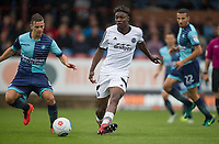 Bernard Mensah of Aldershot Town plays a pass during the pre season friendly match between Aldershot Town and Wycombe Wanderers at the EBB Stadium, Aldershot, England on 22 July 2017. Photo by Andy Rowland.
