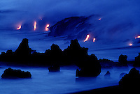 Lava from Kilauea volcano meets the sea to create a bluish other worldly atmosphere