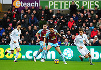 Burnley's Jack Cork vies for possession with Swansea City's Tom Carroll<br /> <br /> Photographer Ashley Crowden/CameraSport<br /> <br /> The Premier League - Swansea City v Burnley - Saturday 10th February 2018 - Liberty Stadium - Swansea<br /> <br /> World Copyright &copy; 2018 CameraSport. All rights reserved. 43 Linden Ave. Countesthorpe. Leicester. England. LE8 5PG - Tel: +44 (0) 116 277 4147 - admin@camerasport.com - www.camerasport.com