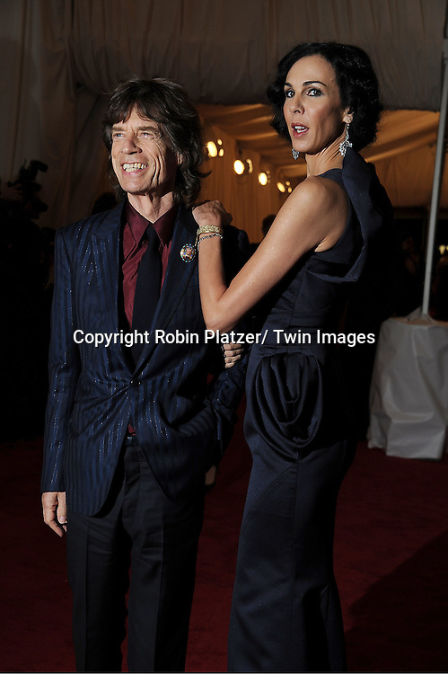 "Mick Jagger and girlfriend L'Wren Scott attends the Costume Institute Gala Benefit celebrating ""Schiaparelli and Prada: Impossible Conversations"".an exhibition at the Metropolitan Museum of Art in New York City on May 7, 2012."