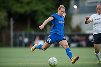 Seattle, WA - Sunday, September 11 2016: Seattle Reign FC forward Manon Melis (14) takes a shot on goal during a regular season National Women's Soccer League (NWSL) match between the Seattle Reign FC and the Washington Spirit at Memorial Stadium. Seattle win 2-0.