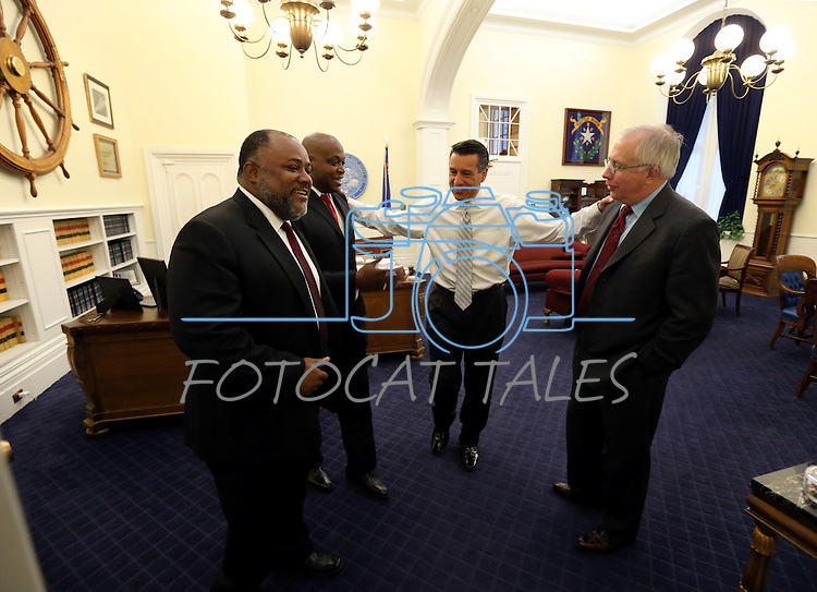 Nevada Gov. Brian Sandoval, center, talks with Assemblymen, from left, Jason Frierson, William Horne and Pat Hickey at the start of a special Legislative session in Carson City, Nev., on Tuesday, June 4, 2013. <br /> Photo by Cathleen Allison