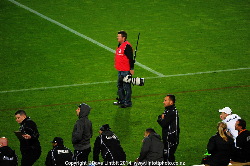 APN photographer Mark Mitchell watches play during the Four Nations rugby league final between the NZ Kiwis and Australia Kangaroos at Westpac Stadium, Wellington on Saturday, 15 November 2014. Photo: Dave Lintott / lintottphoto.co.nz