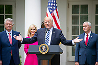 "United States President Donald J. Trump makes remarks prior to signing a Proclamation designating May 4, 2017 as a National Day of Prayer and an Executive Order ""Promoting Free Speech and Religious Liberty"" in the Rose Garden of the White House in Washington, DC on Thursday, May 4, 2017.  From left to right: Pastor Jack Graham; Pastor Paula White of Floridaís New Destiny Christian Center; President Trump; US Vice President Mike Pence. Photo Credit: Ron Sachs/CNP/AdMedia"