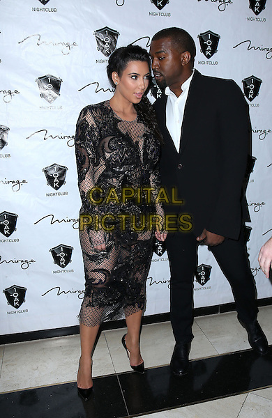 Kim Kardashian, Kanye West.1OAK Nightclub at The Mirage rings in the New Year with Kim Kardashian, Las Vegas, NV., USA..December 31st, 2012.full length black lace dress suit white shirt couple profile goatee facial hair .CAP/ADM/MJT.© MJT/AdMedia/Capital Pictures.