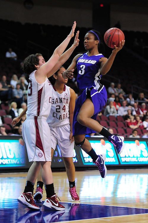 March 1, 2012; Las Vegas, NV, USA; Portland Pilots guard/forward Natalie Day (3) drives to the basket against Santa Clara Broncos guard Ashley Armstrong (23, left) and forward Arteivia Lilomaiava (24) during the WCC Basketball Championships at Orleans Arena.