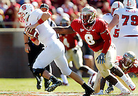 TALLAHASSEE, FL 10/29/11-FSU-NCST102911 CH-Florida State's Timmy Jernigan reaches for N. C. State quarterback Mike Glennon during second half action Saturday at Doak Campbell Stadium in Tallahassee. The Seminoles shut out the Wolfpack 34-0..COLIN HACKLEY PHOTO