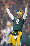 Quarterback Brett Favre #4 of the Green Bay celebrates a touchdown against the Minnesota Vikings in the NFC wild-card game at Lambeau Field on January 9, 2004 in Green Bay, Wisconsin. The Vikings beat the Packers 31-17. (Photo by David Stluka)