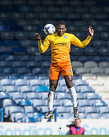 Aaron Pierre of Wycombe Wanderers heads clear during the Sky Bet League 2 match between Portsmouth and Wycombe Wanderers at Fratton Park, Portsmouth, England on 23 April 2016. Photo by Andy Rowland.