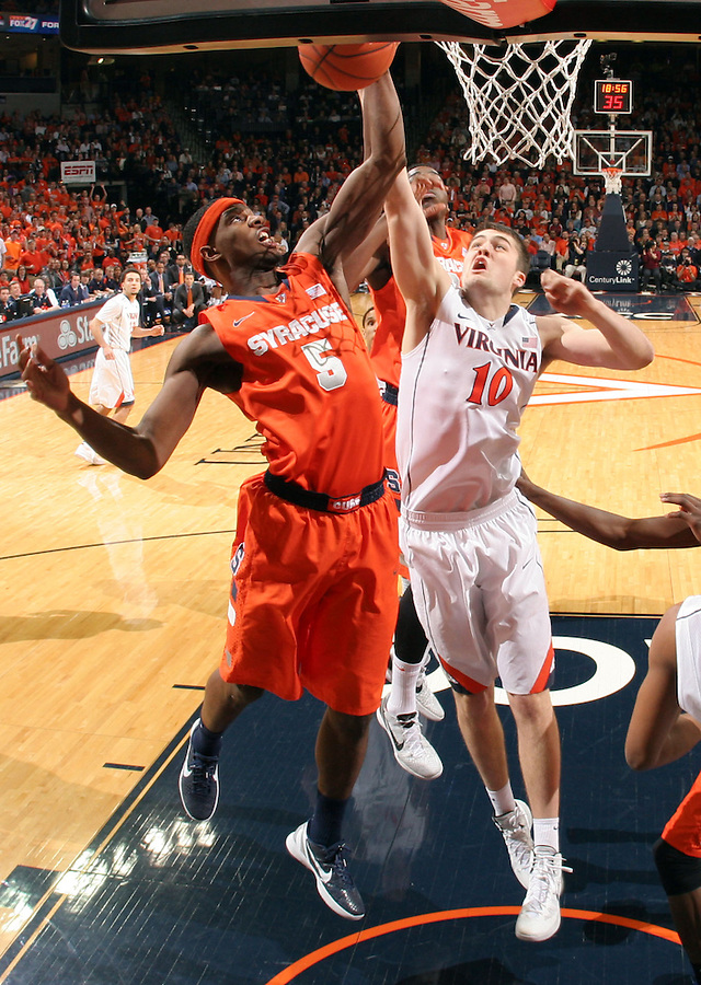 Syracuse forward C.J. Fair (5) grabs a rebound next to Virginia forward/center Mike Tobey (10) during an NCAA basketball game Saturday March 1, 2014 in Charlottesville, VA. Virginia defeated Syracuse 75-56.