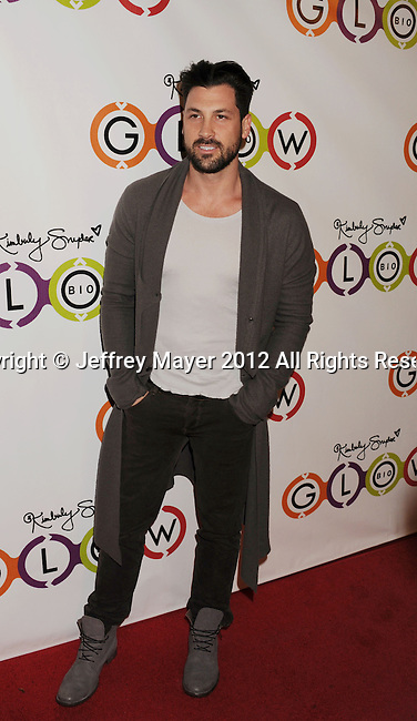 WEST HOLLYWOOD, CA - NOVEMBER 14: Maksim Chmerkovskiy attends the opening of Kimberly Snyder's Glow Bio Juice Bar at Glow Bio on November 14, 2012 in West Hollywood, California.