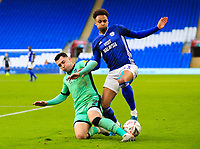 4th January 2020; Cardiff City Stadium, Cardiff, Glamorgan, Wales; English FA Cup Football, Cardiff City versus Carlisle; Josh Murphy of Cardiff City is tackled by Nathan Thomas of Carlisle United   - Strictly Editorial Use Only. No use with unauthorized audio, video, data, fixture lists, club/league logos or 'live' services. Online in-match use limited to 120 images, no video emulation. No use in betting, games or single club/league/player publications