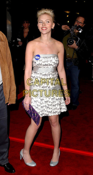 SCARLETT JOHANSSON.The World Premiere of The Perfect Score held at The Cinerama Dome in Hollywood, California .27 January 2004                                                   .*UK Sales Only*.full length, full-length, strapless zebra print black & white fifties style cocktail dress, silver round toe shoes, political badge.www.capitalpictures.com.sales@capitalpictures.com.©Capital Pictures.