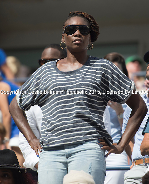Venus Williams watches as sister Serena Williams (USA) loses in the semifinals to Roberta Vinci (ITA) 2-6, 6-4, 6-4 at the US Open in Flushing, NY on September 11, 2015.