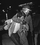 Police officer arresting a demonstrator in Roosevelt, NY in 1968.