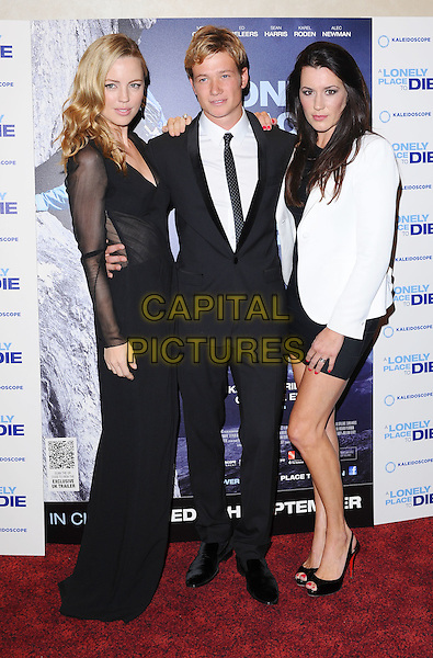 "MELISSA GEORGE, ED SPELEERS & KATE MAGOWAN.""A Lonely To Die"" UK Premiere, Empire Leicester Square, London, England..7th September 2011.full length black dress white blazer sheer sleeves side suit shirt tie .CAP/BEL.©Tom Belcher/Capital Pictures."