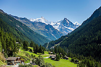 Switzerland, Canton Valais: Ayer VS at Val d'Anniviers with view into Val de Zinal, at background at right summit Besso, 3.668 m; left summit Zinalrothorn, 4.221 m and the Moming Glacier (Glacier de Moming) in the Valais Alps, further right summit Ober Gabelhorn (Obergabelhorn), 4.063 m   Schweiz, Kanton Wallis: Ayer VS im Val d'Anniviers (Eifischtal) mit Blick ins Zinaltal (Val de Zinal), im Hintergrund rechts der Besso, 3.668 m; links das Zinalrothorn, 4.221 m und der Mominggletscher (Glacier de Moming) in den Walliser Alpen, ganz rechts hinten das Ober Gabelhorn (Obergabelhorn), 4.063 m