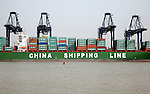 Cranes unloading containers China Shipping Line container ship, Port of Felixstowe, Suffolk
