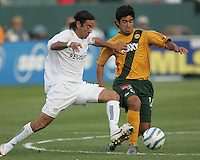New England Revolution's Jose cancela against Los Angeles Galaxy's Paulo Nagamura July 4, 2005 at The Hime Depot Center.