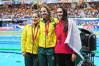 The women's 100m backstroke podium, from left, bronze medalist Australia's Belinda Hocking, gold medalist Australia's Emily Seebohm and silver medalist Wales' Georgia Davies<br /> <br /> Photographer Chris Vaughan/CameraSport<br /> <br /> 20th Commonwealth Games - Day 3 - Saturday 26th July 2014 - Swimming - Tollcross International Swimming Centre - Glasgow - UK<br /> <br /> © CameraSport - 43 Linden Ave. Countesthorpe. Leicester. England. LE8 5PG - Tel: +44 (0) 116 277 4147 - admin@camerasport.com - www.camerasport.com