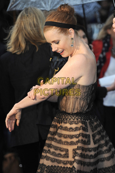 Amy Adams <br /> 'Man Of Steel' UK film premiere, Empire cinema, Leicester Square, London, England.<br /> 12th June 2013<br /> half length beige black strapless dress pattern alice band brown lace hand arm touching side profile <br /> CAP/BEL<br /> &copy;Tom Belcher/Capital Pictures