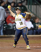 Michigan Wolverines Softball infielder Lindsay Montemarano (18) throws to first during a game against the University of South Florida Bulls on February 8, 2014 at the USF Softball Stadium in Tampa, Florida.  Michigan defeated USF 3-2.  (Copyright Mike Janes Photography)
