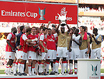 Arsenal's William Galls lifts the Emirates Trophy. .Pic SPORTIMAGE/David Klein
