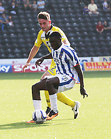Temitope Obadeyi shielding the ball from Jason Naismith in the Kilmarnock v St Mirren Scottish Professional Football League Premiership match played at Rugby Park, Kilmarnock on 13.9.14.